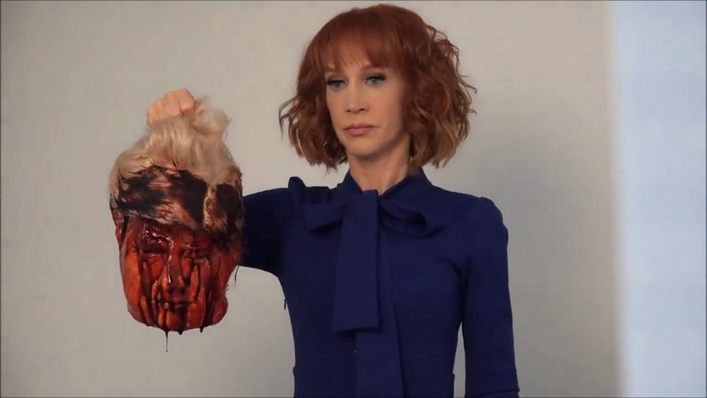 kathy holding the head of trump